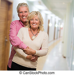 Portrait Of Happy Mature Couple, indoor