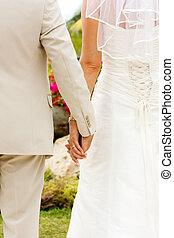 Wedding - Couple holding hands with wedding rings (just...