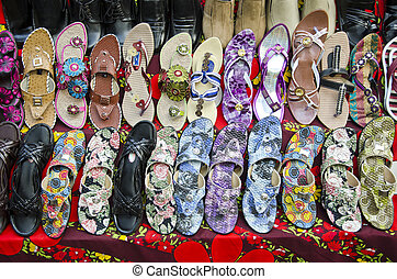 various colorful shoes in India market - various colorful...