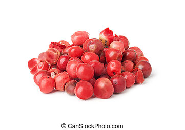 pink pepper - Heap ground pink pepper isolated on white...