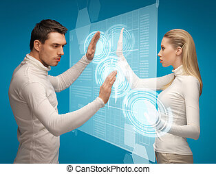 man and woman working with virtual screens - picture of man...