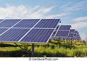 Solar power plant - solar power plant in sunlight on field