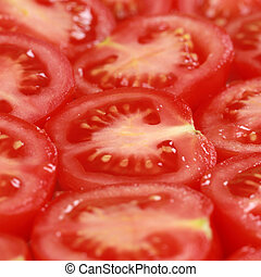 Sliced tomatoes forming a background - Group of red tomatoes...