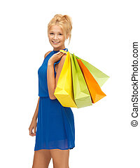 happy teenage girl with shopping bags - picture of happy...