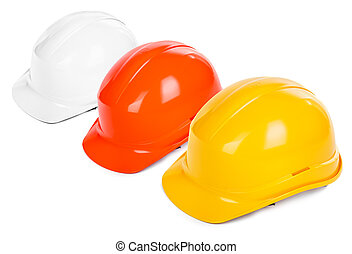 three hard hats on white background, focus set on the yellow...
