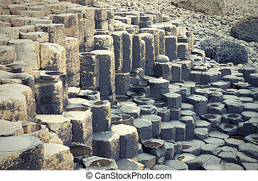 Massive black basalt columns of Giants Causeway in Northern...