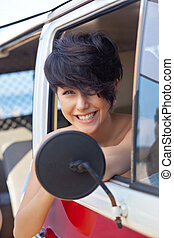 a beautiful young girl with short hair cut and blue eyes - a...