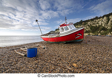 Red Fishing Boat on the Beach at Beer in Devon
