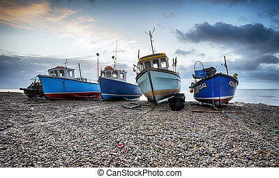 Fishing boats on the beach at Beer in Devon - Fishing boats...