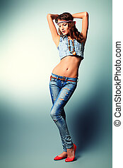 jeans wear - Full length portrait of an attractive young...