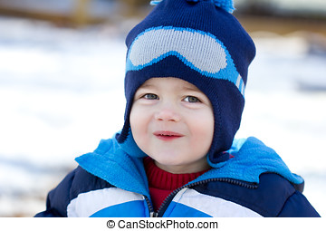 Cute little boy playing in the snow - The photograph is a...
