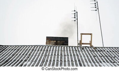 roof chimney smoke snow - old house slate roof covered with...