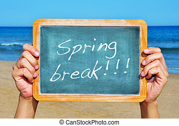 spring break - someone holding a blank blackboard at the...