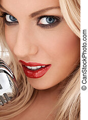 Glamorous blonde vocalist or diva - Closeup cropped headshot...