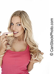 Glamorous blonde eating a cookie - Glamorous blonde woman...