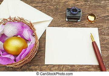 Easter golden egg near the pen to write the letter.
