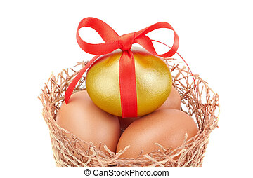 Nest and the band Easter golden eggs. On a white background.