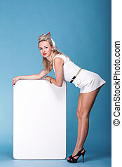 Sexy pinup girl with a blank presentation board - full...