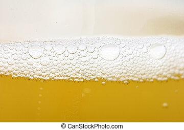 background of yellow beer. macro