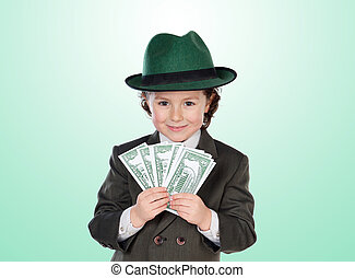 Little businessman with many dolars isolated on green...