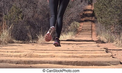 Woman walking up Manitou Incline - Woman walking up the...