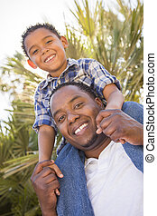 Mixed Race Father and Son Playing Piggyback - Happy Mixed...