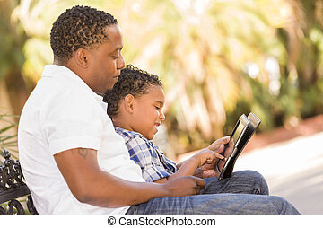 Mixed Race Father and Son Using Touch Pad Computer Tablet