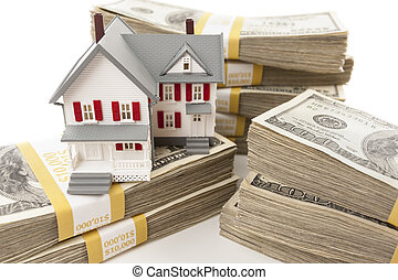 Stacks of Hundreds of Dollars with Small House - Stacks of...