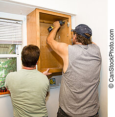 Installing Cabinets - Teamwork - Carpenter and helper...