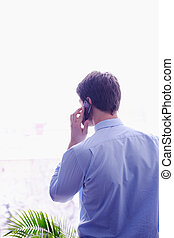 business man talking by cellphone in office
