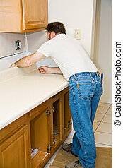 Installing Kitchen Counter - Contractor installing a new...