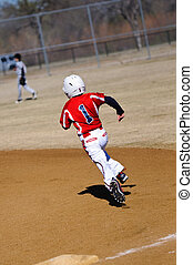 Little league baseball player running bases - Little league...