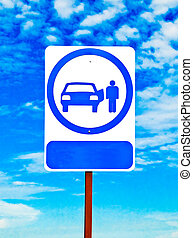The Sign of shuttle bus or taxi isolated on blue sky background