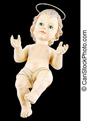 Baby Jesus - antique figure of baby jesus isolated on black...