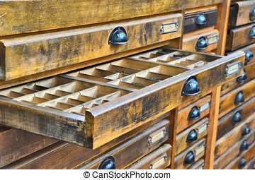 in an old printing - Drawers with letters in an old printing