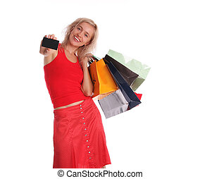 Happy woman with a card and set of purchases 2