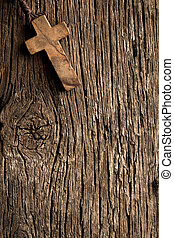 antigue wooden cross on old wooden background - the antigue...