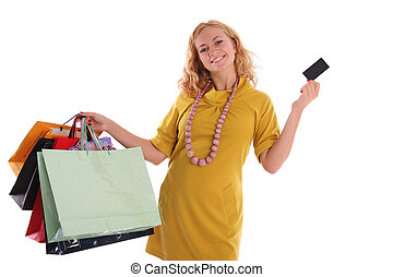 Happy woman with a card and set of purchases