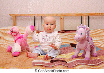 Baby plays with toys 1 - The beautiful happy baby plays with...