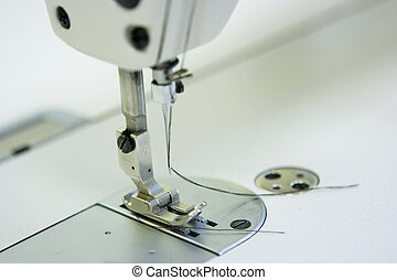 Sewing machine - A sewing machine and on a table