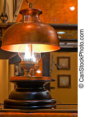 Old kerosene lamp with copper shade