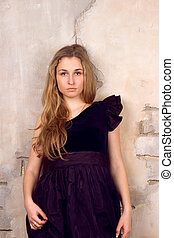 Beautiful blonde near the wall - Beautiful blonde with her...
