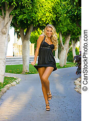 Coquette - Black dress looking good on young blondy