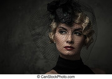 Elegant blond retro woman with red lipstick wearing little...