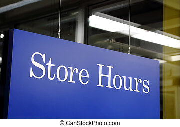 Store hours sign in the shop