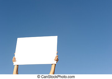 Hands holding blank billboard blue background - Hands...