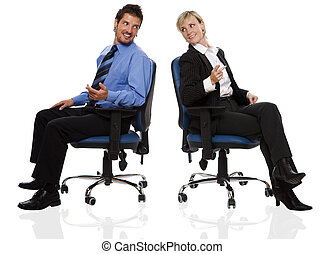 couple - young business couple sitting on chairs and talking