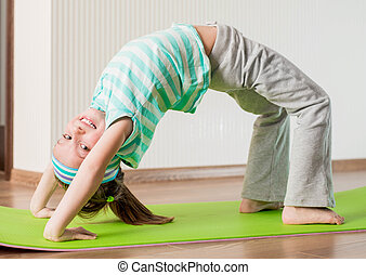 little girl doing gymnastic exercises - smiling girl with...