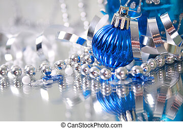 Christmas Decorations - A lovely blue baubles on a mirror...