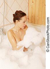 Beautiful nude woman in the tub